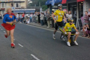 The 'Wheelbarrow race' during Combe Martin's Carnival Week